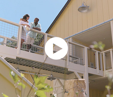 Video thumbnail with couple standing on balcony