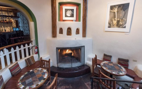 fireplace with tables and chairs