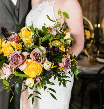 close up of a bride's bouquet with purple and yellow flowers
