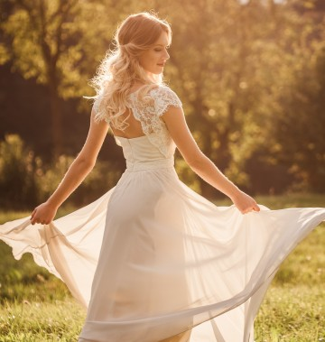 bride spinning around in a field