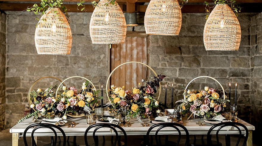 handling decorative pendants over a table with floral centerpieces