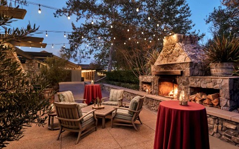 outside lounge and dining space near a fire pit