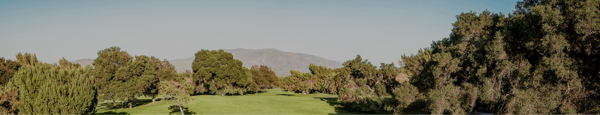 golf course with mountain backdrop
