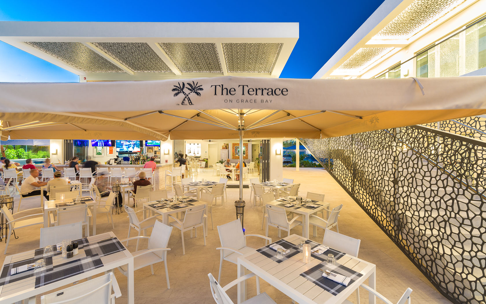 the terrace covered outdoor dining area at night