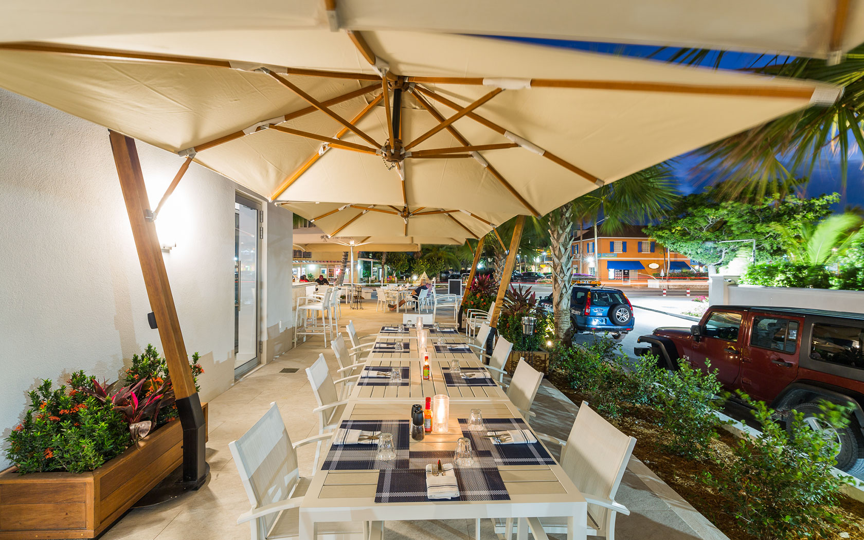 covered outdoor seating area at night