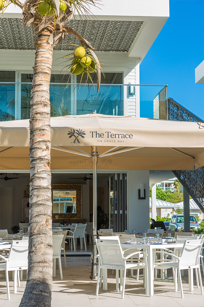 exterior of the terrace on grace bay restaurant with an open restaurant and covered outdoor seating