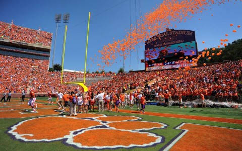 Inside of Clemsons memorial stadium with orange balloons above