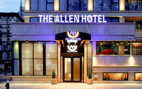 the allen hotel entrance exterior at night