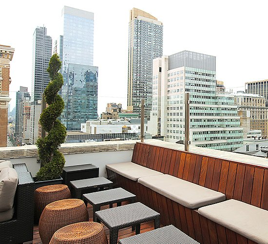 rooftop lounge overlooking new york city