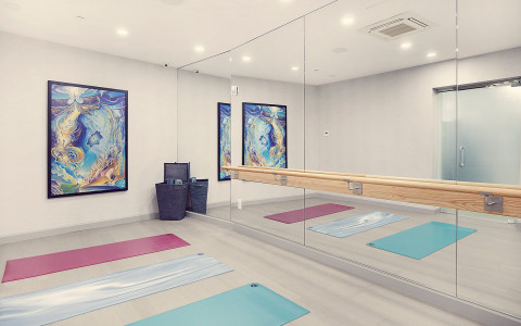 yoga room with a mirror wall