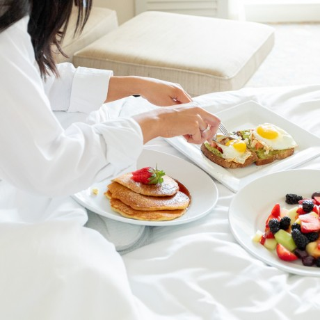 cutting up breakfast in bed