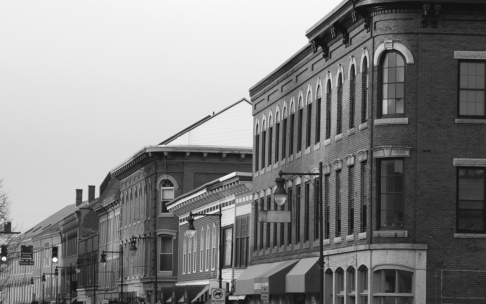 greyscale picture of brick buildings