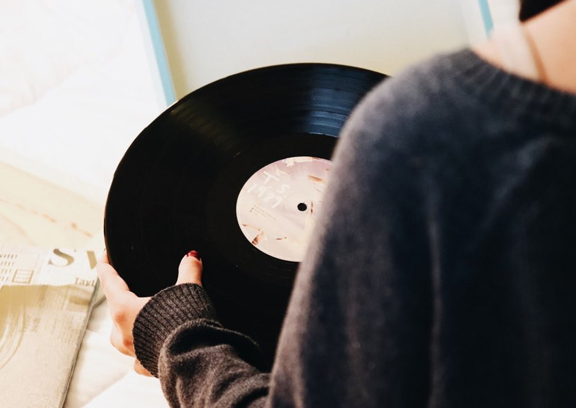 woman holding a vinyl record
