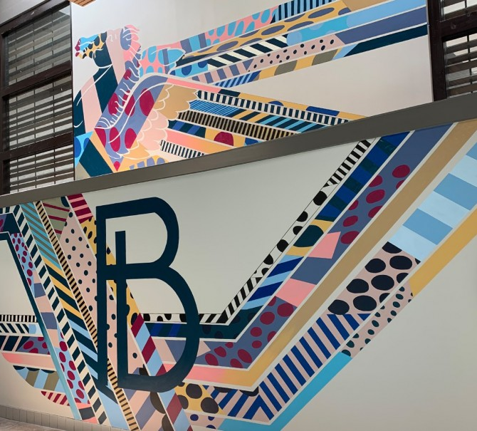 The letter B painted into a pattern on the wall