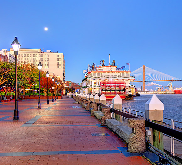 view of the boardwalk in savannah overlooking the river