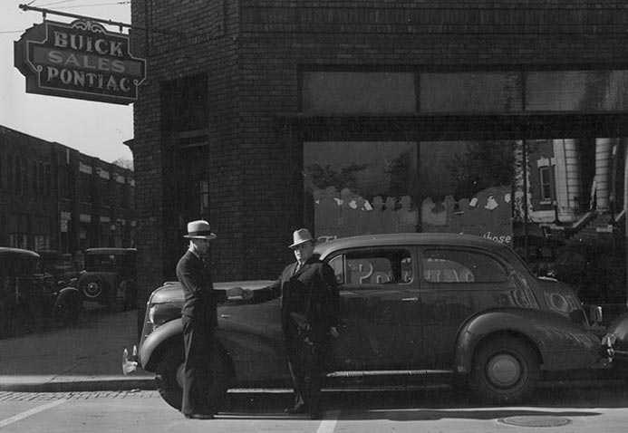 old photograph of two men and a car