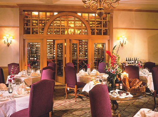 Wine dining room with wine display in background