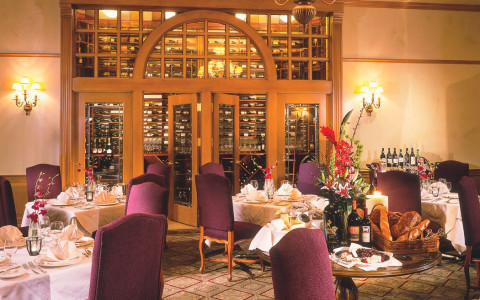 A dining room set up for dinner in an upscale restaurant