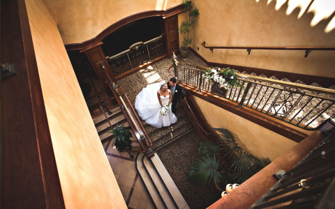 bride and groom walking down the staircase
