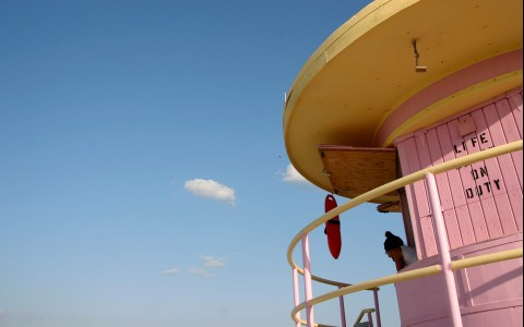 pastel pink and yellow lifeguard tower