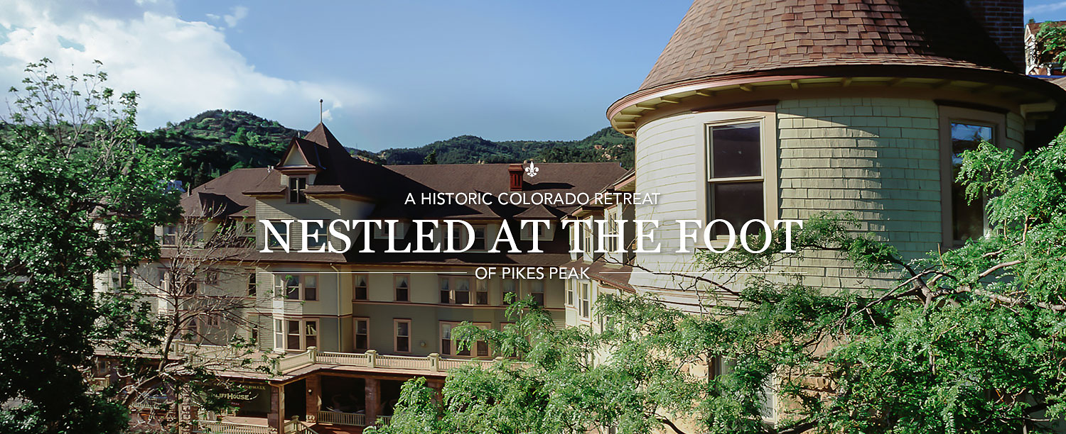 Historic Colorado Retreat Nestled at the food of Pikes Peak with hotel in background