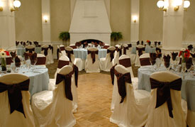 Ballroom of hotel set up with circular tables and chairs