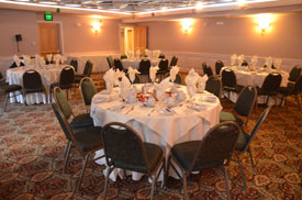 big room with large circular set dining tables and chairs
