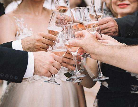 group of people clinking champagne glasses