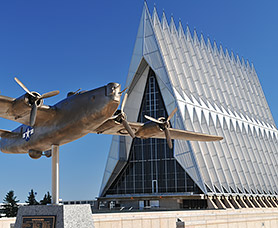 exterior of an air force building with statue of an airplane