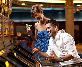 a couple enjoying cocktails and playing a casino game