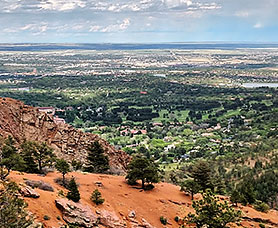 view of the green North Cheyenne Canon Park from the top of a mountain