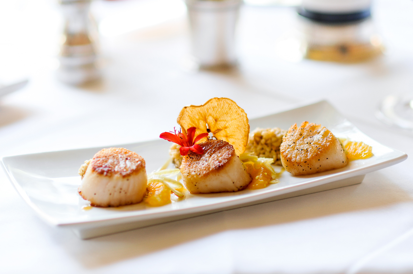 scallop appetizer on a white plate