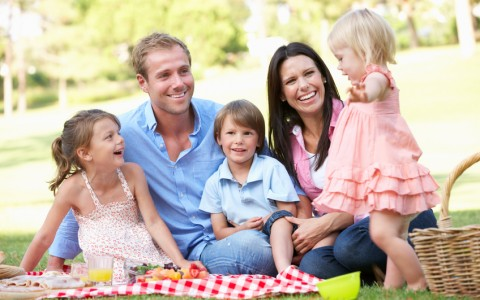 young family enjoying a picnic
