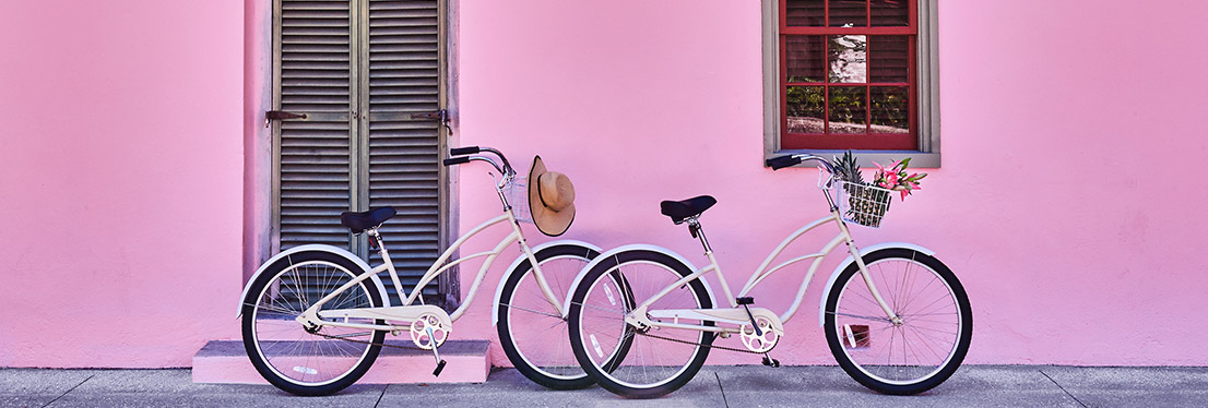 Bikes against pink wall