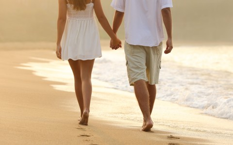 couple walking down the beach