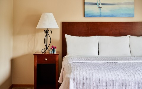 hotel bed with nightstand