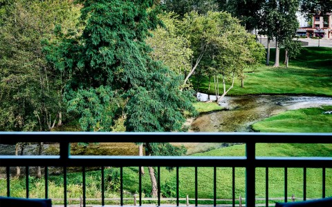 lush greenery and a stream overlooked from balcony