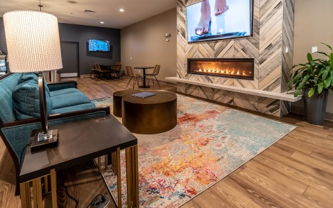 indoor sitting area with a fireplace and tv