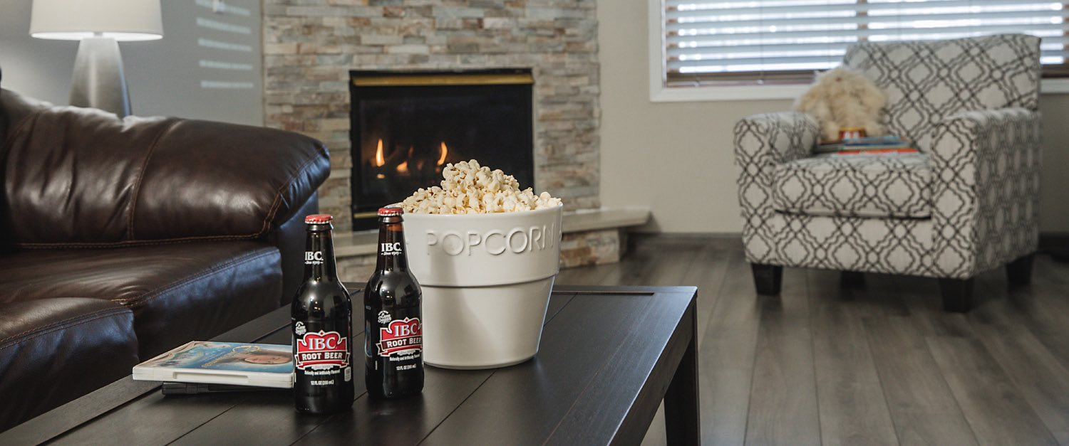 popcorn and coca cola on wooden table