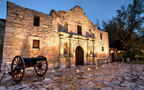 close up of the alamo with lights at night