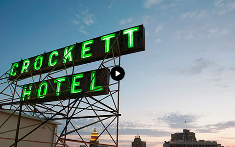 neon green crockett hotel sign