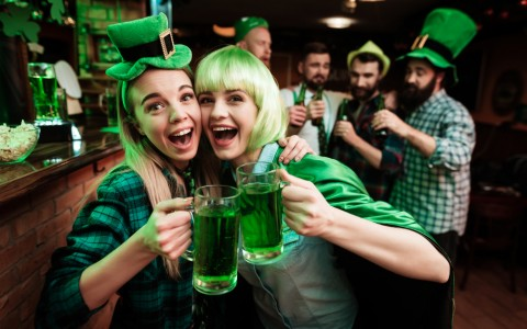 two girls wearing green wigs for saint patricks day