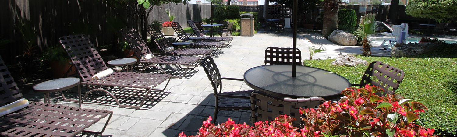 outdoor patio table and lounge chairs