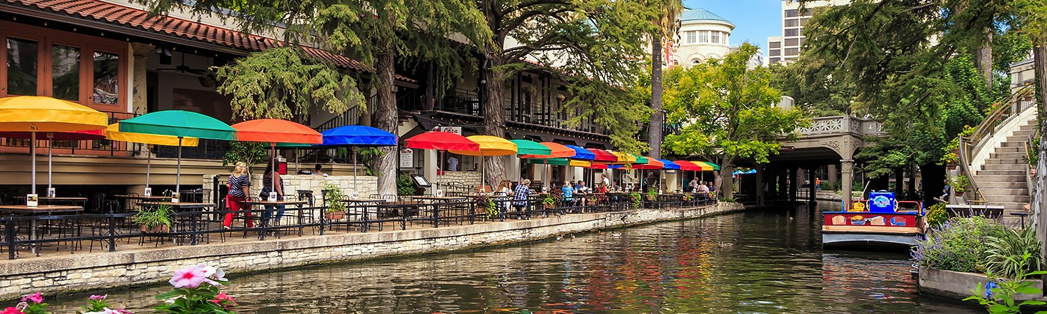 riverwalk area with a line of colorful umbrellas