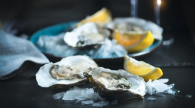 close up of oysters and lemons