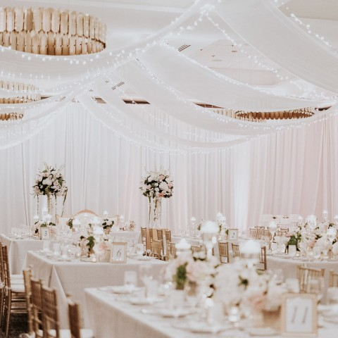 wedding reception area with white tapestries