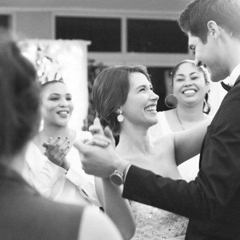 couple surrounded by friends having their first dance