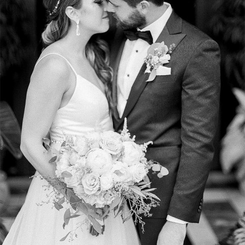 black and white image of bride and groomabout to kiss