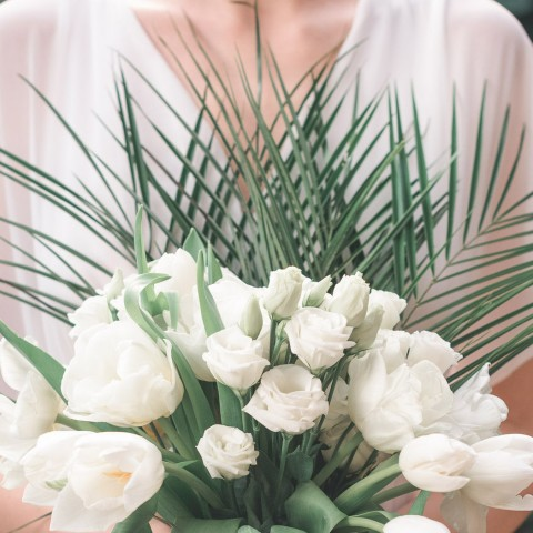 bouquet of white roses with green foliage