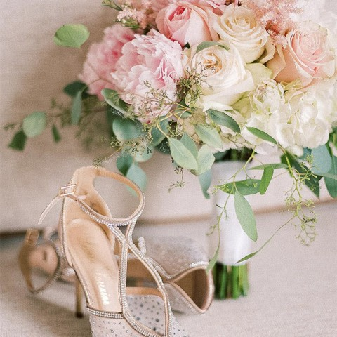 bride's jeweled heels next to pink bridal bouquet with roses and peonies